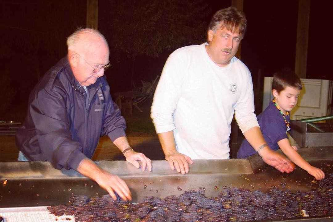 The men of the Coleman family during one of their first harvests